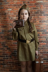 Little girl in military uniform at the May 9 celebration in Russia, Victory Day.