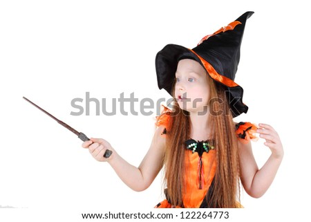 Little Girl In Orange Costume Of Witch For Halloween Holds Wand ...
