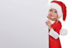 little girl in red santa hat  peeking from  billboard.