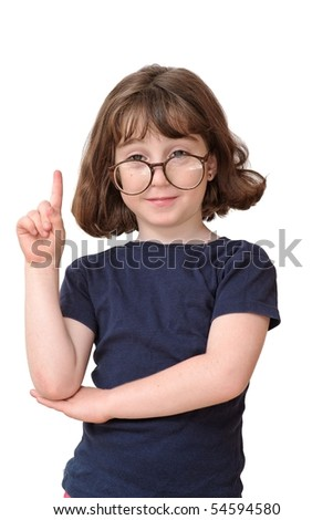 Little girl in round spectacles raising finger in attention gesture isolated