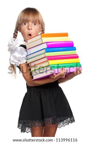 Little girl in school uniform with books isolated on white background