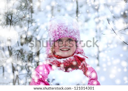 Little girl in snow forest.