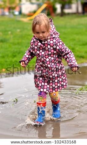 Little girl in splash - stock photo