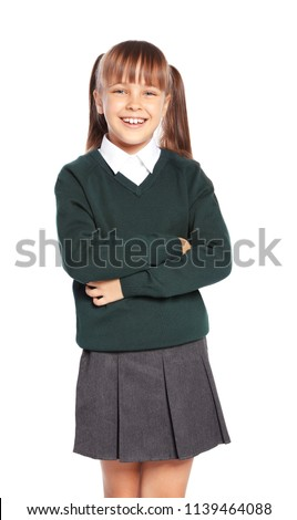 Little girl in stylish school uniform on white background