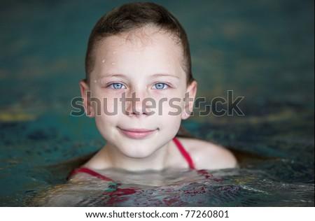 Little girl in swimming pool - stock photo