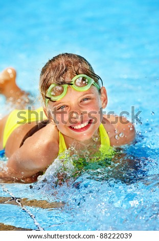 Little girl in swimming pool. Summer outdoor.