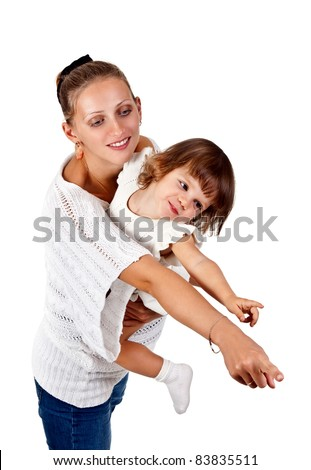 little girl in the arms of my mother, point the finger at the studio isolated on a white background