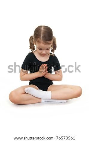 little girl in the lotus position children's yoga stock