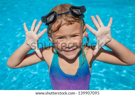 little girl in the swimming pool