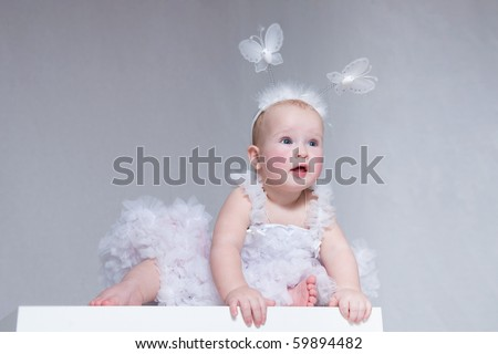 Little girl in white beautiful dress