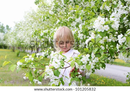 little girl in white clothes in spring park - stock photo