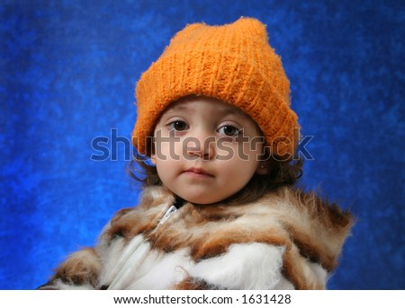 Little girl in winter outfit looking at camera. Look at my gallery for more winter images