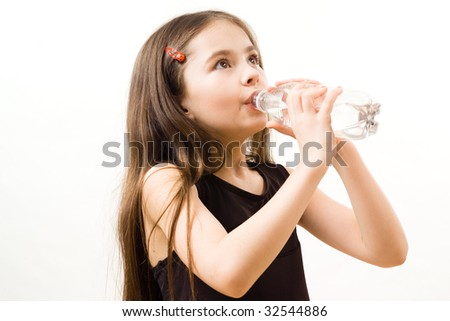 Little girl is drinking water