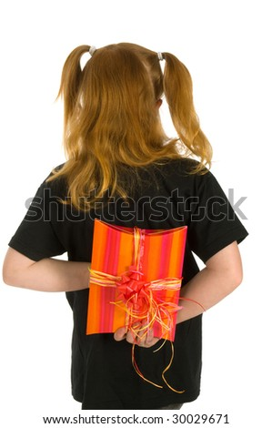 Little girl is hiding a present behind her back