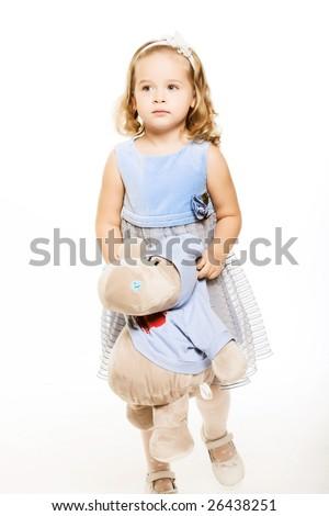 Little girl is hugging big teddy bear