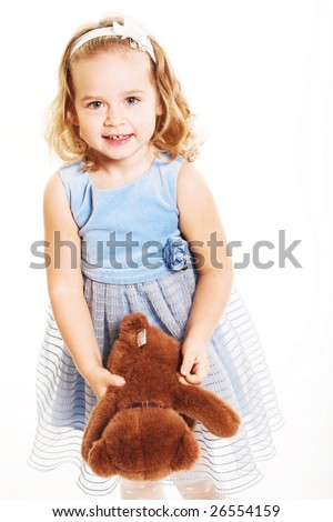 Little girl is hugging big teddy bear