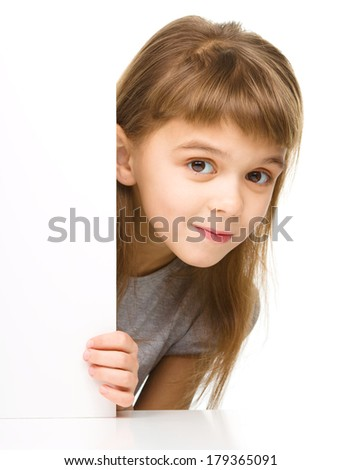 Little girl is looking out from the blank banner, isolated over white