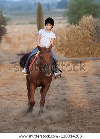little girl is riding a horse