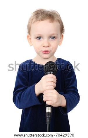 Little girl is singing with a microphone