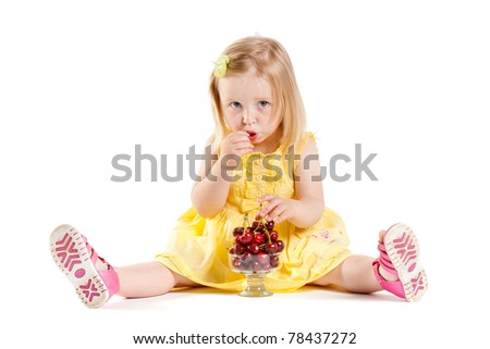 little girl is sweet cherries - stock photo