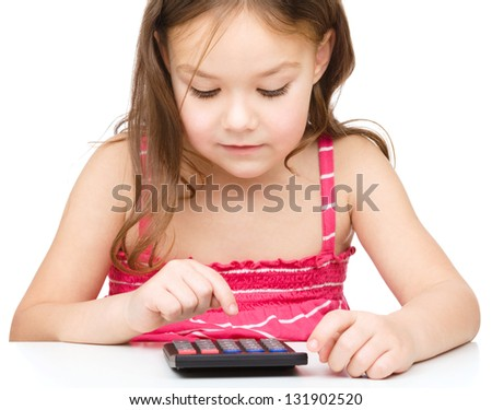 Little girl is using calculator, isolated over white