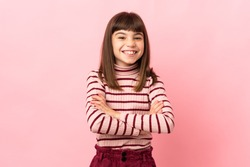 Little girl isolated on pink background keeping the arms crossed in frontal position