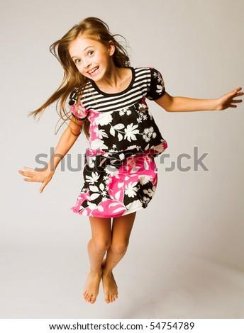 little girl jumping of joy - stock photo