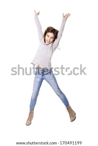Little girl jumping over a white background