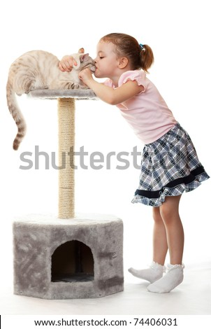 Little girl kisses her cat. Mad Love.