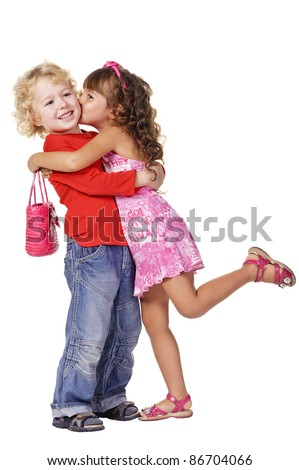 little girl kissing beautiful little boy. Isolated over white