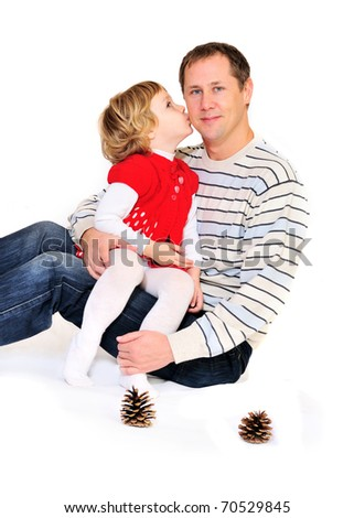 little girl kissing father's cheek