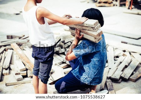 Little girl labor working in commercial building structure, World Day Against Child Labour concept.
