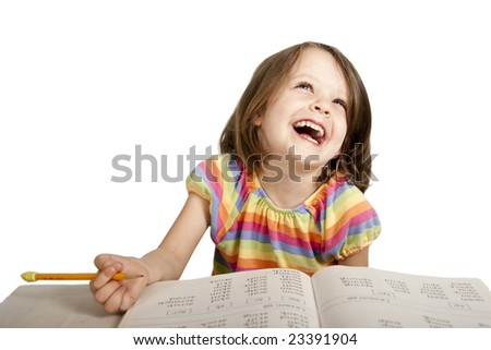 little girl laughing while studying reading book
