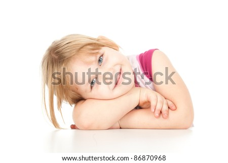 little girl leaning on table, white background