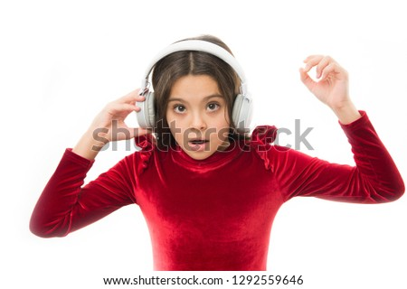 Little girl listen music wireless headphones. Online music channel. Girl little child use music modern headphones. Listen for free new and upcoming popular songs right now. Music always with me. #1292559646