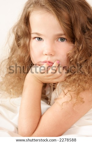 Little girl looking pensively