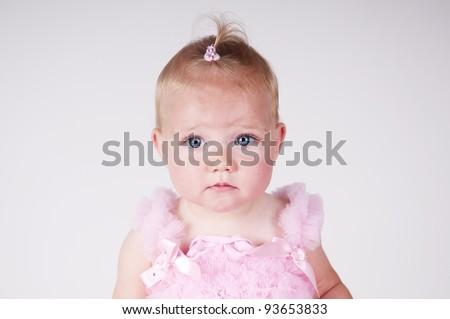 little girl looking sad