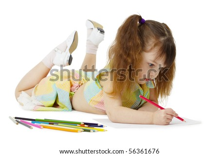 Little girl lying on the floor, drawing with crayons