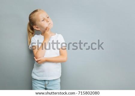 Little girl making serious face