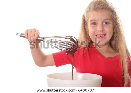 little girl mixing brownie batter