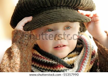 little girl model try on big cap