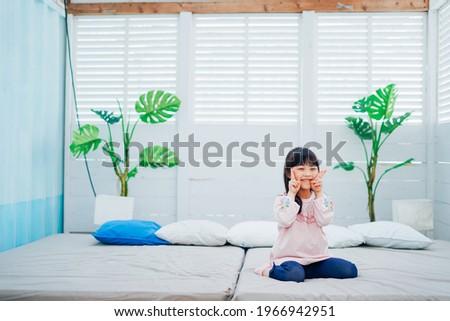 Little girl on a swing Stock photo ©