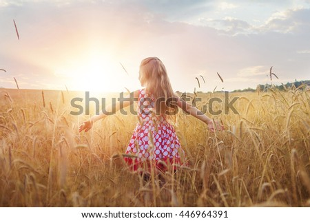 little girl on a wheat field...