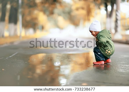 little girl on an autumn walk in the park #733238677
