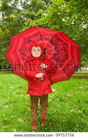 little girl on an umbrella in park