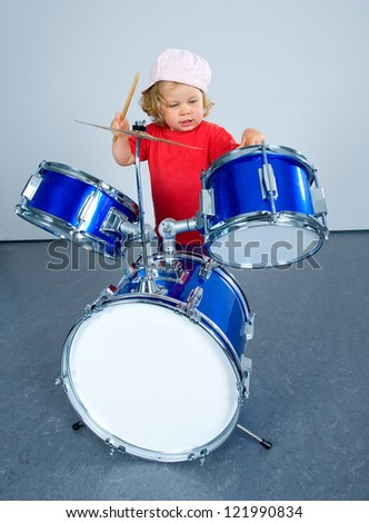 little girl on the drums