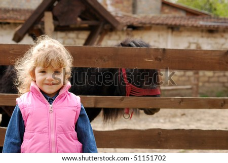 little girl on the farm