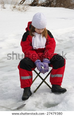 Little girl on the ice fishing