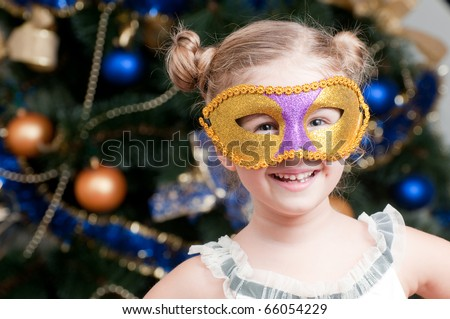 Little girl on the masquerade