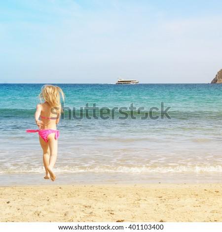 Little girl on the sand beach. Summer vacation #401103400